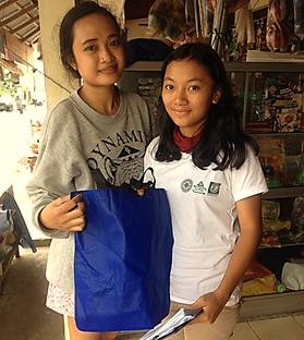 girls holding eco friendly bag