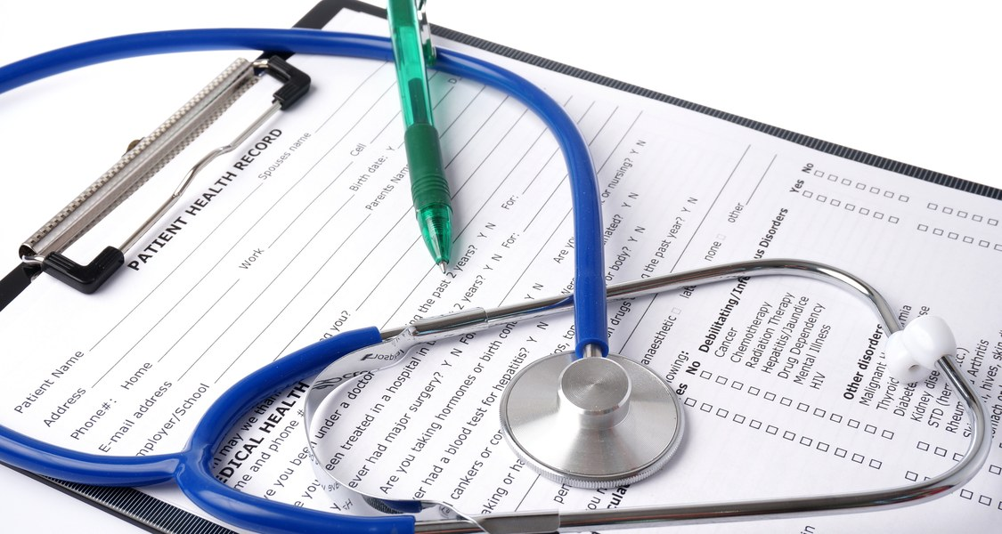 A stethoscope placed on a medical form.