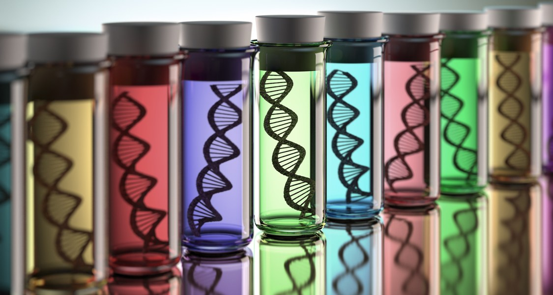 Several large colourful test tubes containing models of DNA double helixes.