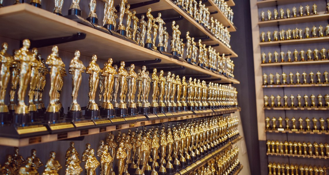 A room filled with shelves of identical human-shaped trophies. (Kind of like the Oscars)