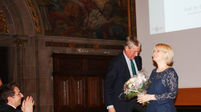 Professor Dr. Christoph Safferling (at the left) welcoming his successor Professor Dr. Stefanie Bock (at the right), and Professor Dr. Eckart Conze (in the middle).