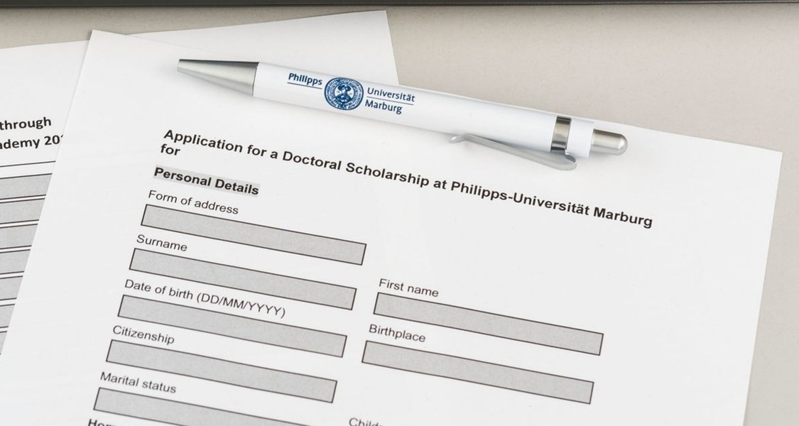 Form for a doctoral scholarship with a ballpoint pen
