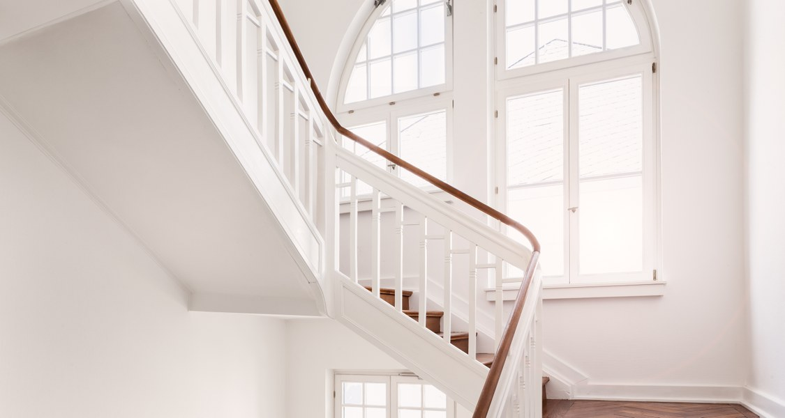 White stairway with a window